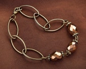 Vintage style bronze faceted glass bead bracelet with large oval chain