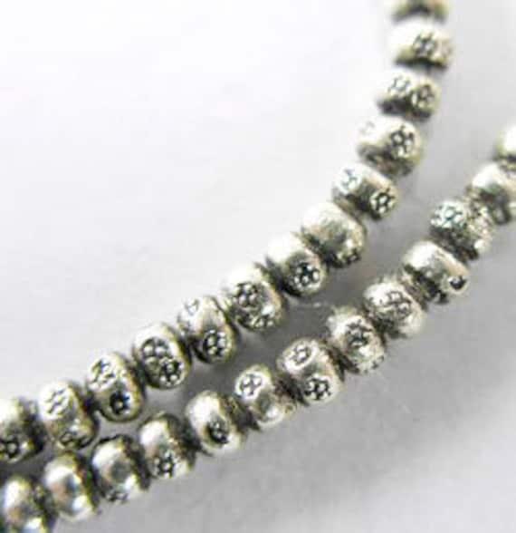 100 of Karen Hill Tribe Silver Imprint Seed Beads 2.5x1.5 mm. :ka2570