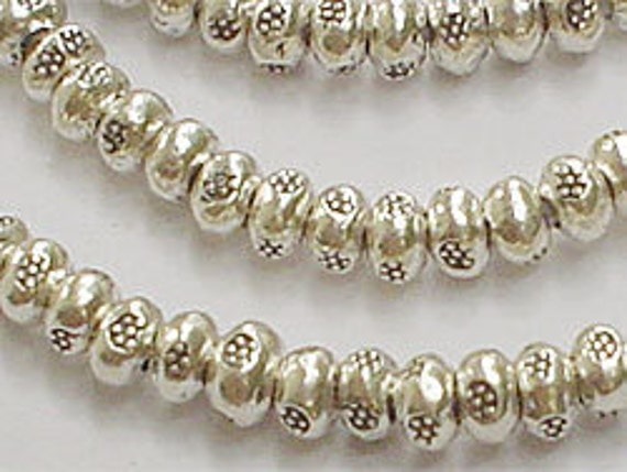 40 of Karen Hill Tribe Silver Daisy Imprint Seed Beads 3.3x2 mm. :ka0171