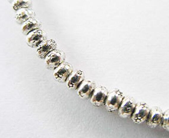 40 of Karen Hill Tribe Silver Imprint Seed Beads 2.7x1.5 mm. :ka2969
