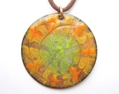 Copper enamel pendant- orange, green and yellow spiral mandala - large