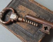 Vintage metal corkscrew stylized as sceleton key. Bottle opener.
