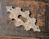 Vintage metal key hole escutcheon, plate, finding