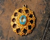 Vintage filigree Pendant, embellished with blue grass rhinestone.