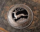 Vintage metal plate, part of brooch, finding, image of deer.