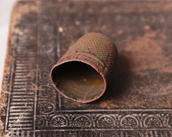 Antique big  brass thimble. Black patina