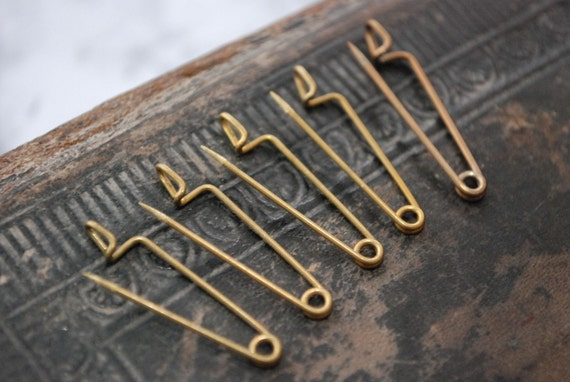 Set of 10 antique brass brooch back pins, clasps from 1920-1930s