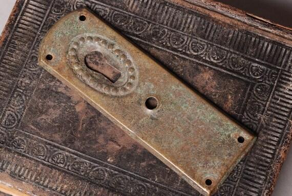 Vintage Art Nouveau style key hole escutcheon .