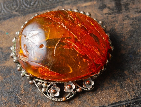 Vintage filigree brooch with baltic amber stone