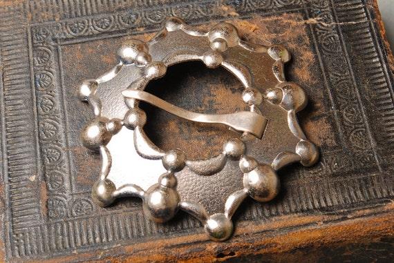 Vintage big brooch styled as penannular brooch.