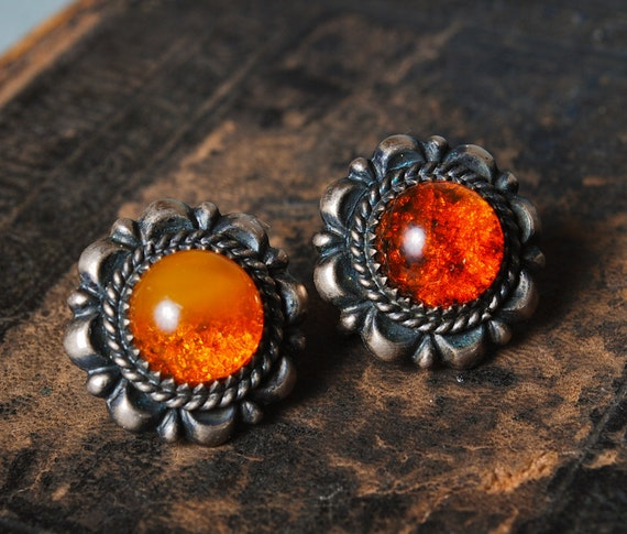 Pair of Vintage clip on  earrings, silver tone metal with natural Baltic amber.