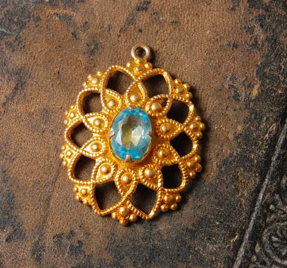 Vintage filigree Pendant, embellished with blue grass rhinestone.
