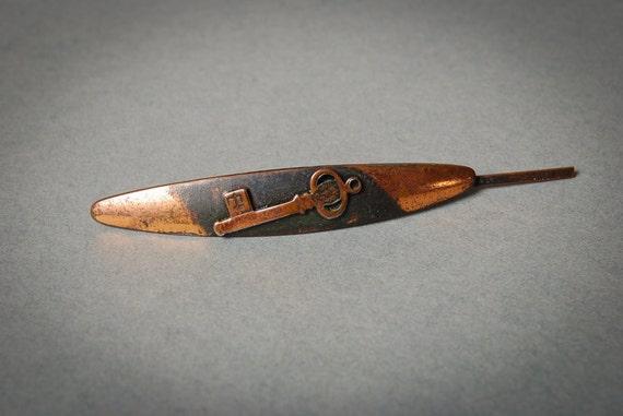 Vintage copper tie bar clip, old skeleton key