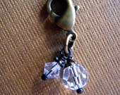 Add a  Charm -Clear Swarovski crystals  on Vintage antique brass.