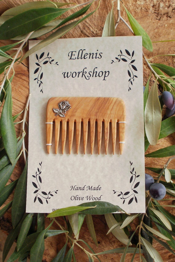 Hand carved Greek Olive Wood hair comb inlaid with Tibetan silver rose