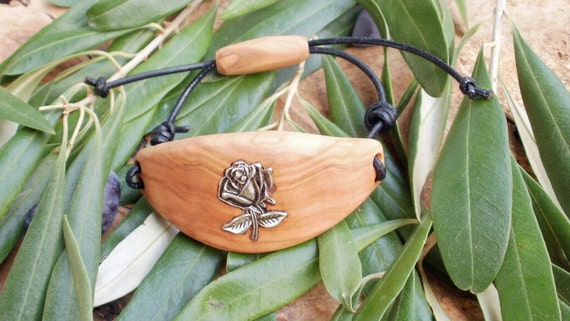 Hand carved Greek Olive Wood bracelet  inlaid with Tibetan silver rose