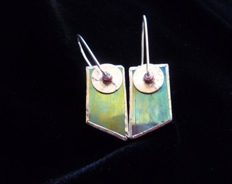 Irridized glass earring reflects blue and gold