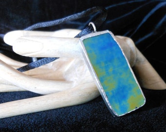 Stained glass irridized pendant in blue and gold
