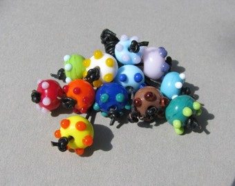 Handmade lampwork glass beadset, 12 beads in vibrant colors by Flamejewels.