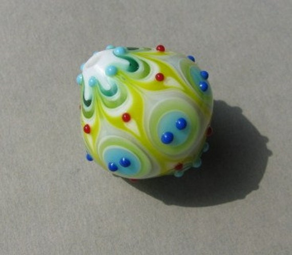 Handmade lampwork glass bead in yellow, different shades of green, blue and white by Flamejewels