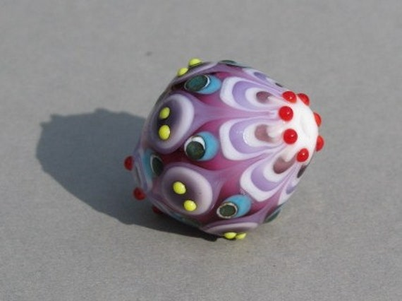 Handmade lampwork glass bead in different shades of purple and white by Flamejewels