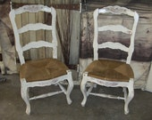 White ladder back chairs with wicker seats. (2 available)
