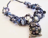 Statement Necklace Owl themed with Black, Navy, and Silver Beads, and a Black and Gold Owl Focal