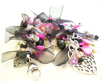 Charm Bracelet with Chunky Pink, Black, White, and Green Beads and Black organza Ribbon.