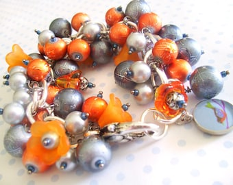 Charm BRACELET with burnt Orange and Silver Pearl Beads and Flowers and Small Bird Charm, Lobster Clasp 8 inches
