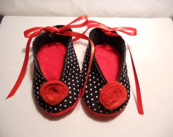 Black, white and red felt baby shoes