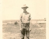 1940's photo .Skinny farmer