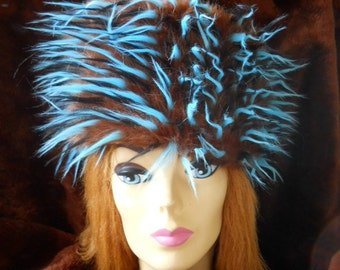 FURNOGGIN is a fun faux fur hat that will keep you warm and feeling loved. Handwas/Air-dry