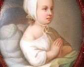 Antique miniature portrait of young girl praying on porcelain