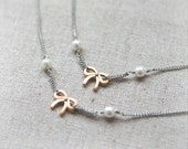 Tiny gold ribbons and white pearls layered Long Necklace