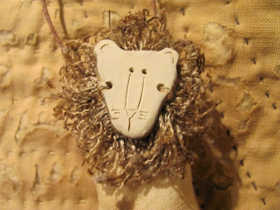 Sam a Primitive Lion Ornament