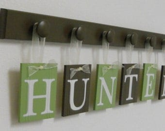 Baby Room Decor. Set Includes Pegs and Custom Baby Hanging Name Letters painted Light Green and Chocolate Brown. Personalized Baby Gift