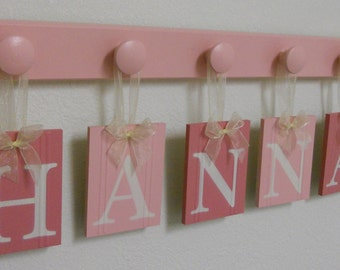 Baby Name Wall Hanging Sign Set Includes Wooden Pegs Painted Pinks and Light Pink.  Custom Hanging Letters