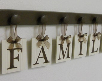 FAMILY - Cottage Sign, Home Decor Wood Sign, Wood Hanging Block Letter Sign Includes 6 Wooden Peg Board Hooks Painted In Chocolate Brown