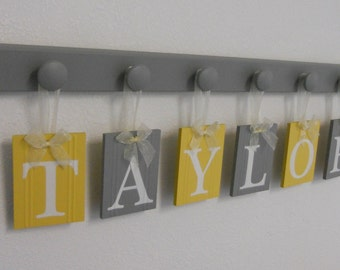 Baby Girl Wooden Letters Sign Includes Personalized Alphabet Wall letters and Pegs Painted Gray with Yellow and Grey Letter Tiles