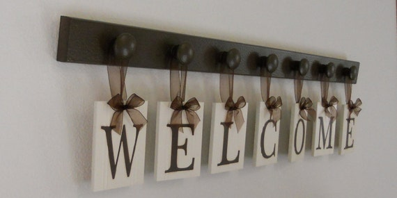 Wood WELCOME Sign - Home Wall Decor - Hanging Ribbon Letters - Wooden Peg Hook Display - Painted Chocolate Brown - Entryway Art - Entry Sign