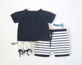 A knitted sweater and striped shorts in white and navy blue. 100% cotton. Newborn.
