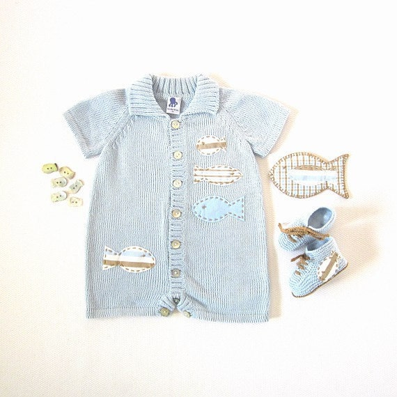A knitted short jumpsuit in soft blue with fishes