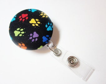 Badge Reel Covered Button in Paw Prints