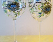 Handpainted wine glass with bluebird and nest. Set of two.