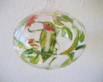 Glass Christmas ornament with hummingbirds and trumpet vine flower, hand painted.