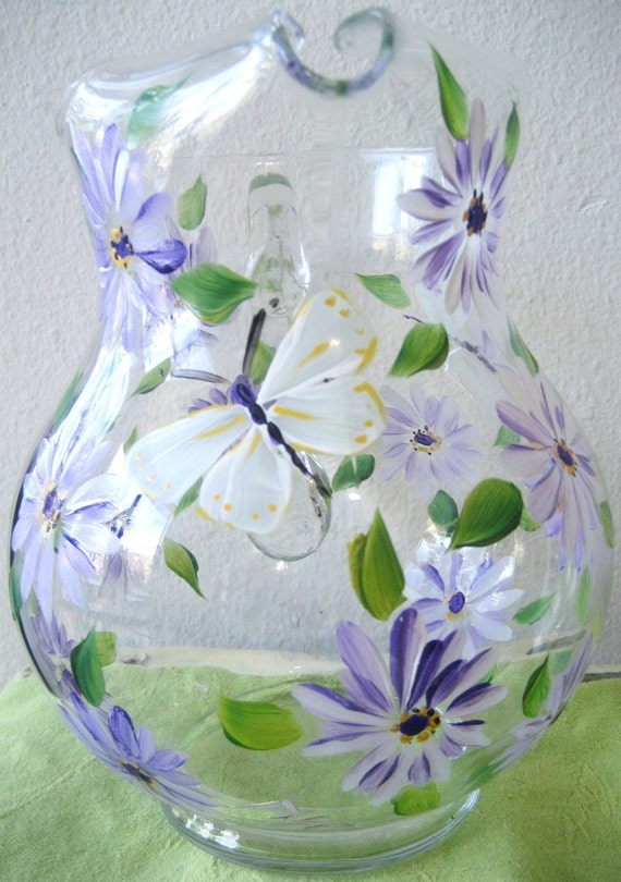 Handpainted glass pitcher with daisies