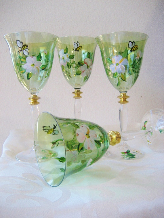 Hand painted wineglasses with white dogwood and gold accents. Set of four
