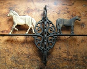 Vintage Cast Iron Horse Sign with Scroll Work