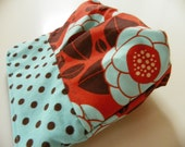 Little Makeup Bag -- Minty Blooms on a rusty orange background -- oilcloth interior