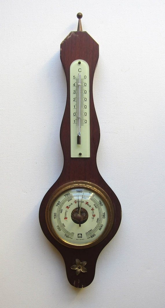 Vintage colonial style barometer and thermometer